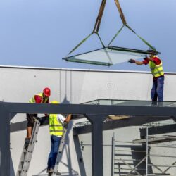 builders-workers-outdoors-installing-large-size-glass-belgrade-serbia-june-glass-roof-installation-builders-workers-outdoors-168633005