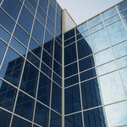 modern-office-building-with-glass-windows-blue-sky-texture-high-rise-building_156843-534